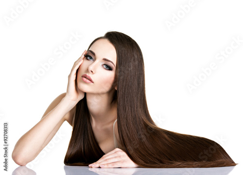 Portrait of beautiful young woman with long straight brown hair Poster
