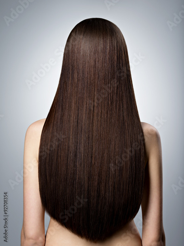 Poster Woman with long brown straight  hair. Rear view