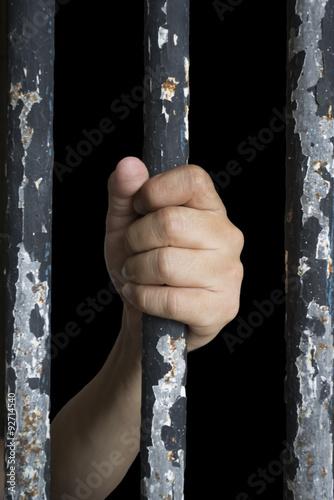 Poster Prisoner hand holding iron bar