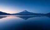mountain Fuji at dawn with peaceful lake reflection
