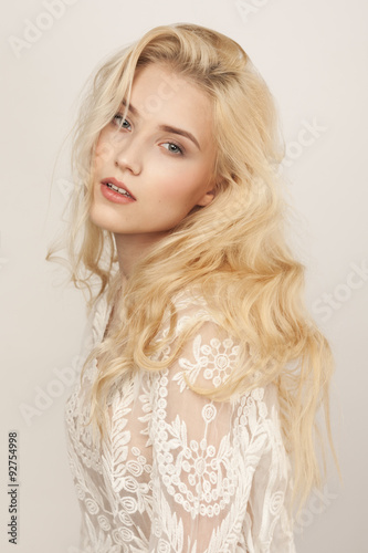 Fotobehang Kapsalon Studio portrait of a beautiful young blond woman
