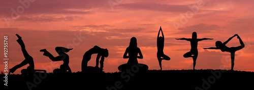 Wall mural Silhouette of a beautiful Yoga woman