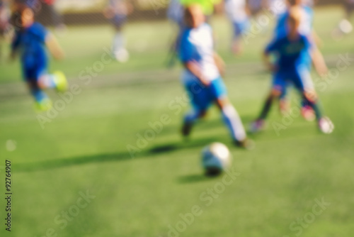 Kids playing soccer Poster