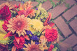 Vintage filter effect of bouquet of autumn flowers against brick background