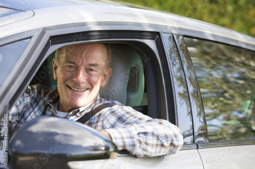 Portrait Of Smiling Senior Man Driving Car Poster