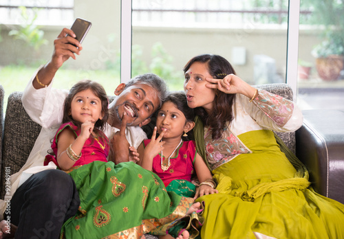 Poster Asian Indian family selfie or self photograph at home. Parents a