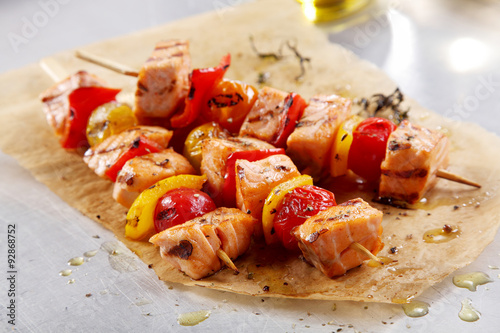Fish Kebabs on Paper on Top of a White Table Poster