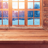 Fototapety Christmas background with wooden empty table over window and winter nature lanscape. Winter holiday wooden house interior