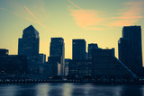 Canary Wharf modern buildings in London on river Thames