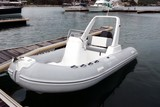 White Inflatable Rubber Speed Motor Boat At The Berth
