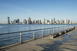 City skyline of Jersey City and Hoboken New Jersey from a pier  in New York City across the waters of the Hudson River