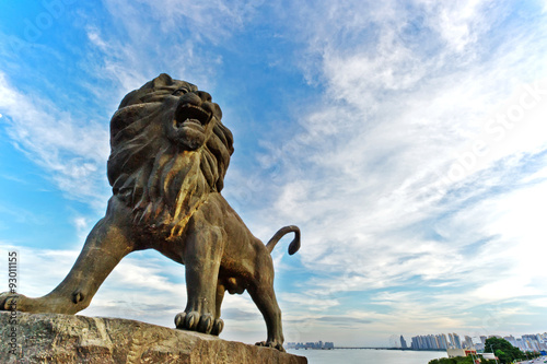 Stone Lion sculpture, symbol of protection & power in Oriental Asia especially C Poster