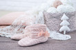 Knitted handmade house decorations still life with trendy high boots