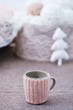 Knitted handmade decoration for a cup