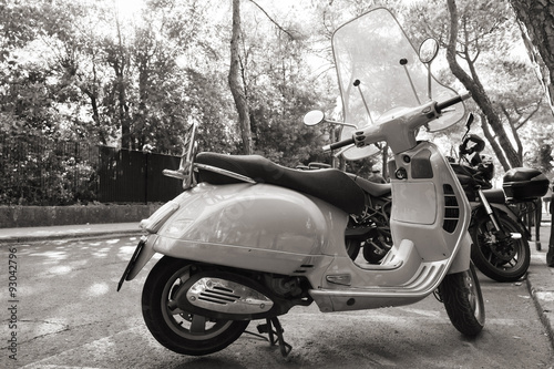 Foto op Canvas Scooter Classic old style Vespa scooter stands parked