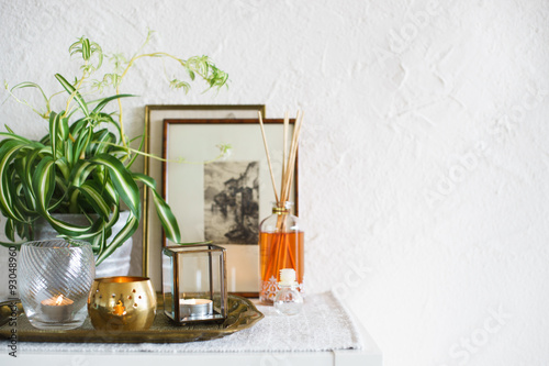 Poster Vintage home decor: candles, aroma diffuser, plant and frames