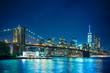 Beautiful night scene of New York City and Brooklyn Bridge looking toward Manhattan