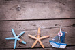 Decorative sailing boat and marine items on  aged wooden backgro