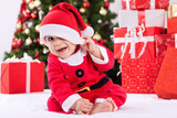 Funny smiling baby santa claus