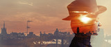 Double exposure of girl wearing hat and city sunset letterbox