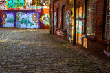 Fototapety Looking down a long colorful alley
