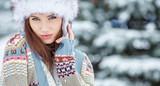 Fototapety Young woman winter portrait. Shallow dof.