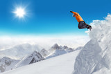 Jumping snowboarder at jump