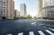 empty asphalt road of a modern city with skyscrapers - 93376314