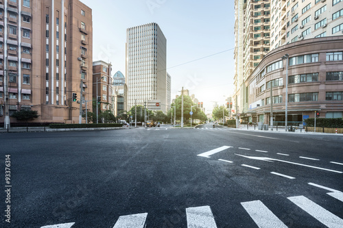 empty asphalt road of a modern city with skyscrapers © zhu difeng