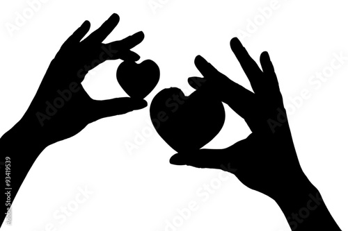 Silhouettes of hands with hearts, isolated on white