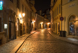 Night view of old street  in Mala Strana (Little Quarter) in Prague. Czech Republic