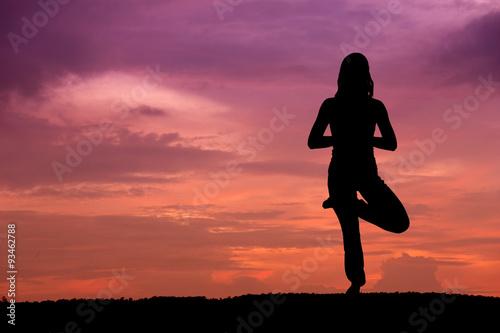 Fotobehang Jacht Silhouette of a beautiful Yoga woman