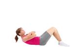 Sporty woman doing sit-ups - 93482945