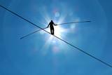 Highline walker in blue sky concept of risk taking and challenge - 93516378