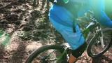 Biking as extreme and fun sport. Downhill Biking. Women in sport.