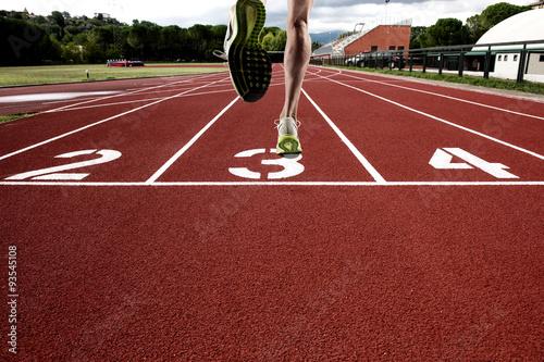 Fototapeta Run on athletic track