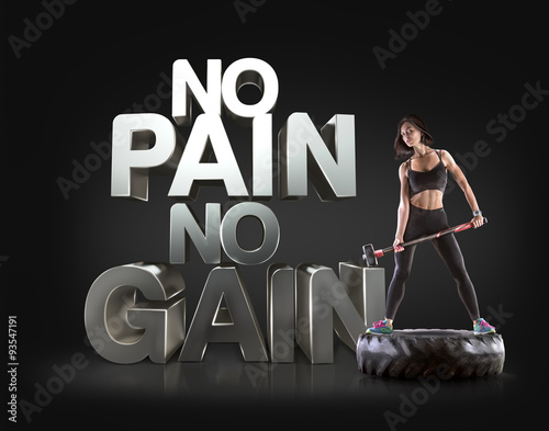 Fototapeta Sport woman holding a hammer on the background Motivational fitness phrases