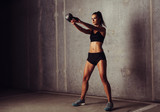 Fototapety Slim attractive sportswoman in a kettlebell training