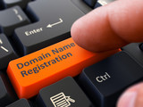 Finger Presses Orange Keyboard Button Domain Name Registration.