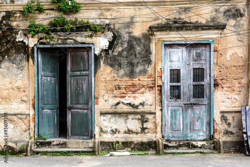 old ancient door and window with old grunge brick wall - 93609393