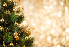 Christmas tree background with gold blurred light