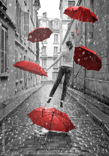 Girl with red umbrellas flying above-ground. Conceptual