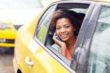 Fototapety happy african woman calling on smartphone in taxi