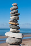 Stones pyramid on beach symbolizing harmony,balance