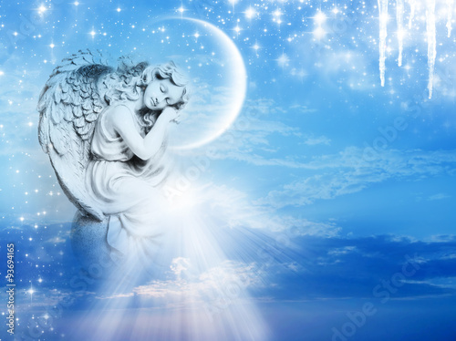 an angel statue over mystical sky with divine light and stars Poster