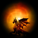 a statue of dragon over orange mysterious backround