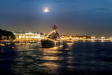 Warships in the waters of the Neva River in St. Petersburg at ev