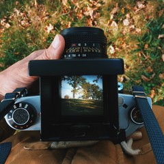 man photographer is making  landscape photography with old film camera