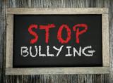 Stop Bullying written on chalkboard poster
