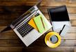 Office desk with laptop computer, tablet pc, planner, pen, mobil
